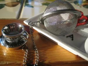 Tekula med silverfigur